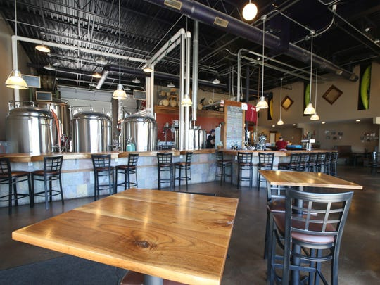 The large and bright bar and dining area at Swiftwater Brewing on Mt. Hope Avenue in Rochester Wednesday, April 26, 2017.