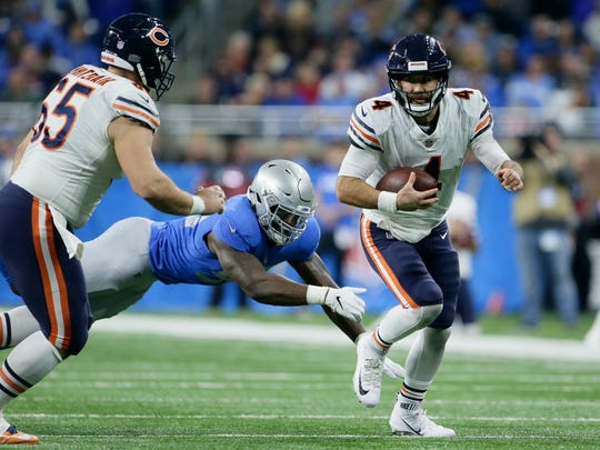FILE - In this Nov. 22, 2018, file photo, Chicago Bears quarterback Chase Daniel (4) scrambles during the second half of the team's NFL football game against the Detroit Lions in Detroit. Daniel, the team's backup quarterback, last week helped defeat the Detroit Lions 23-16 as a replacement for injured Mitchell Trubisky without benefit of a real practice. With the Bears preparing Wednesday to face the New York Giants on Sunday, Daniel took the snaps with the first team while Trubisky practiced only on a limited basis with the shoulder injury he suffered Nov. 18 against the Minnesota Vikings. (AP Photo/Duane Burleson, File)