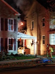 Firefighters deal with a fire at 651 Broadway in Hanover on Saturday night.