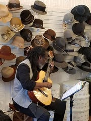 Jazz Guitarist John Kizzie during Small Business Saturday at the Hat Shop in Madison.