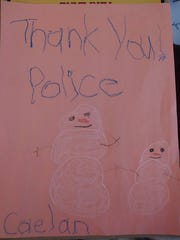 Caelan Hoisington, 6, Annville, drew this picture for the Annville Township Police Department as a thank you to the officer, Jason Cleck, who rebuilt Hoisington's snowman after someone kicked it over March 22.
