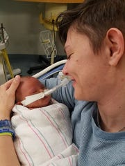 Amanda Kapes with her son, Greyson, who passed away