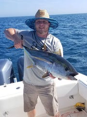 Nate Melton of Toms River with a yellowfin tuna he