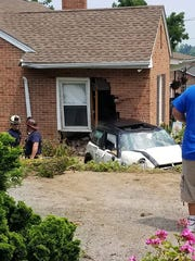 A car fleeing a traffic stop crashed into this home in the 3000 block of North George Street in Manchester Twp. on July 4, 2018, state police said.