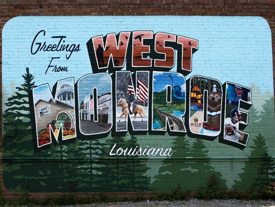 "A postcard mural that reads ""Greetings from West Monroe"""