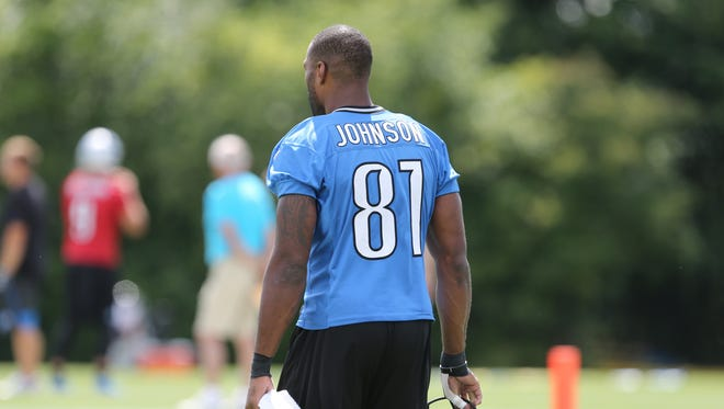 Detroit Lions wide receiver Calvin Johnson walks to the field before training camp on Tuesday, August 4, 2015 at the practice facility in Allen Park.
