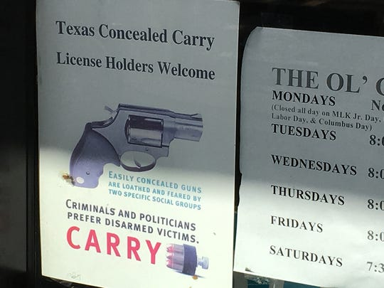 """A sign outside of the door of the Ol' Clip Joint hair cutting business at 7930 N. Mesa, Suite B3, welcomes concealed-carry patrons. Owner Ruben Valles said he does not have a problem with open carry patrons, either, """"as long as it for the right reason."""" Valles said some his customers are law enforcement personnel who routinely carry their weapons."""