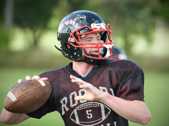 Rocori quarterback Mason Primus steps back to throw during practice Tuesday, Aug. 22, in Cold Spring.