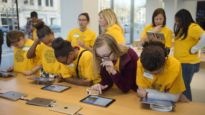 From left, Carolyn Forgues, JaNae Sudduth, Kiara Odums, Nicole Klann and Lola Valdovino, all members of the Kansas City Girls Who Code club, complete a lesson on computer coding on iPads at the Apple store on the Country Club Plaza.