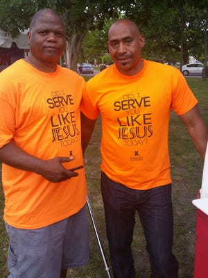 Bishop Ray Mott, founder and pastor of New Rochelle's Family Christian Center, left,  and member Mark Phelps at the organization's community outreach to give back and serve local communities.