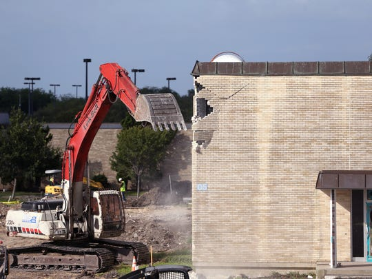 The first strikes are made in the demolition of the English building at Del Mar College's East campus on Friday, June 23, 2017. Demolition of the building is expected to last about two weeks.