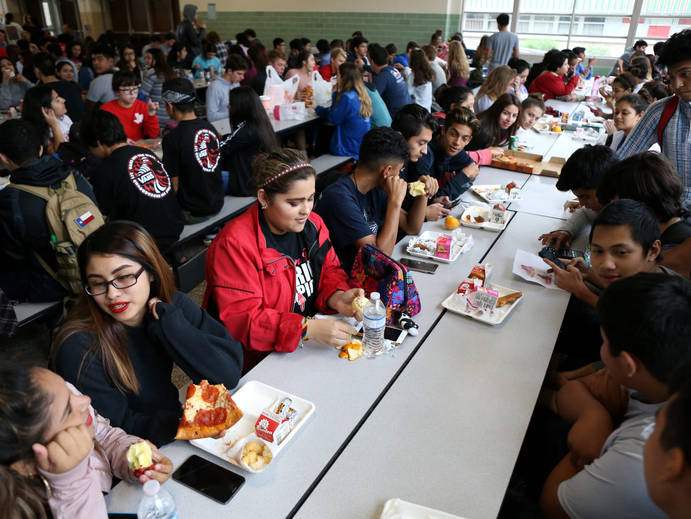 Claudia Jimenez, 19, eats lunch with her small group of friends on November 8, 2017. Her goal of graduating and going to college and making it against all odds pushes her every day to get up. She has an opportunity her older and younger sister were not able to get, she said.