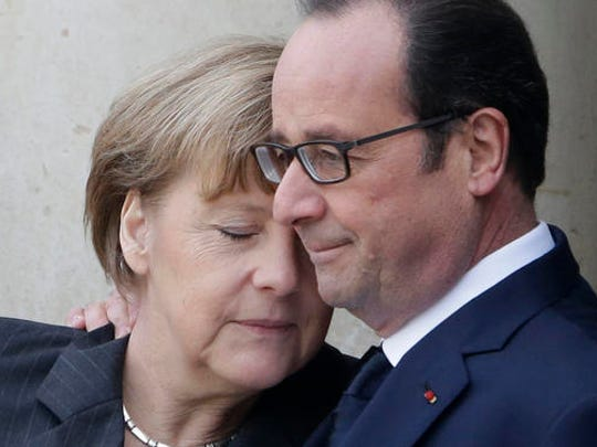 "FILE - In this Sunday, Jan. 11, 2015 file picture, French President Francois Hollande embraces German Chancellor Angela Merkel, left, as she arrives at the Elysee Palace, Paris, France. French President Francois Hollande says he decided against running for another term because he wants to give his Socialist party a chance to win ""against conservatism and extremism."""