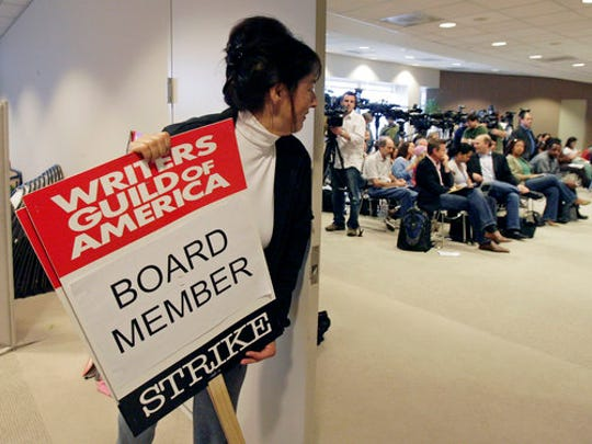 FILE- In this Feb. 10, 2008, file photo, Writers Guild of America board member Nancy De Los Santos, who's also a film and television writer, waits for a news conference to start in Los Angeles. Members of the Writers Guild of America are one step closer to striking come May 2, 2017. In a letter to its members Monday, April 24, the WGA said 96.3 percent voted to authorize a strike as the May 1 contract expiration deadline looms.