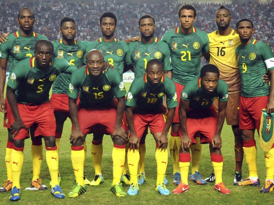 FILE - In this Oct. 13, 2013 file photo, Cameroon soccer team poses prior to the start the World Cup qualifying soccer between Tunisia and Cameroon in Tunis, Tunisia. Foreground from left: Tchounko Nounke, Kouamo Webo, Takang Enouh Eyong and Jean Makoun. Background from left: Allan Romeo Nyom, Bilong Song, Ndoubena Nkoulou, Fongang Chedjou, Job Mtip Joel and Samuel Etoo. (AP Photo/Salah Habibi, File) - SEE FURTHER WORLD CUP CONTENT AT APIMAGES.COM