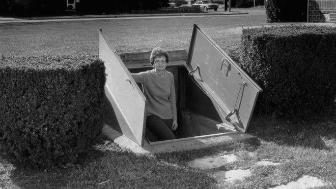 Sat 6/12/99 Flashback      Greenfield resident Helen Oldham never had to use this fallout shelter for protection from nuclear attack. Instead, the underground bomb shelter that she and her husband, Dr. William R. Oldham, had built in their yard at 925 W. Main St. after the 1961 Cuban Missile Crisis was used by their children for slumber parties.