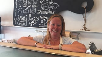 Emily Frank at the cheese counter of her business Share: Cheesebar.