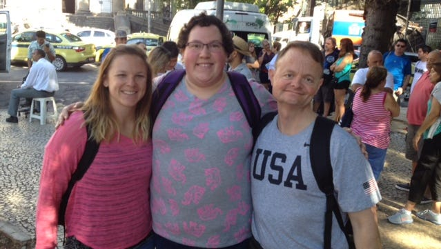 Dr. Mark Lavallee, right, poses with USA Weightlifting's Samantha Zimmerman, left, and 2012 Olympian Sarah Robles in Rio de Janeiro. USA Weightlifting is competing in a test event ahead of the 2016 Olympics in August.