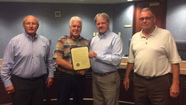 On July 27, the Marion County commissioners presented a proclamation to Marion Cemetery Superintendent Jim Riedl. From left are Commissioner Ken Stiverson, Riedl, Commissioner Kerr Murray and Commissioner Andy Appelfeller.