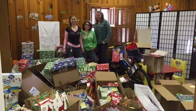The Christmas Cheer Drive for the Eastern Shore Coalition Against Domestic Violence is in full swing, raising money and collecting gifts for families at the shelter. In 2016, organizers, from left, Melanie Parker, Madison Mello and Leesa Kelly used donations to fulfill the wish lists of 13 families at the shelter.