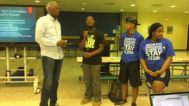 School choice advocate and former Milwaukee Public Schools Superintendent Howard Fuller talks with students at North Division High School during a June 28 forum on the future of the school.