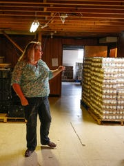 Natalie Oehler, manager of the Carmel United Methodist Church Food Pantry, talks about the food storage area in the basement of their pantry on Monday, April 24, 2017.