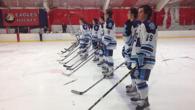 CBA Ice Hockey stands at attention.