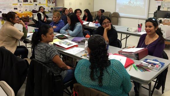 Parents take an English class at O'Shea Keleher Elementary School.