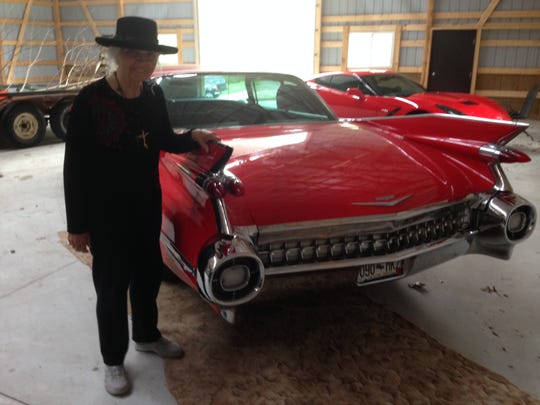 Rhea Woltman's classic car collection includes a red