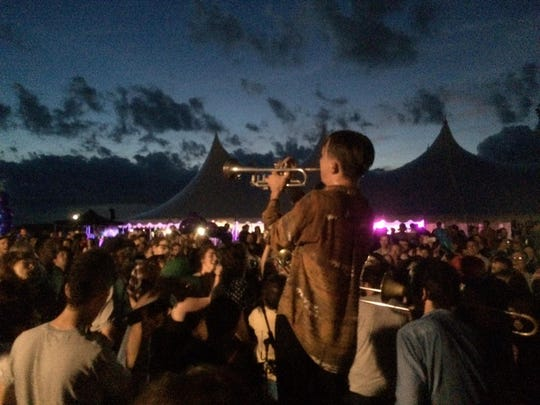 Alex Toth plays his trumpet as Rubblebucket concludes its show Saturday at Waterfront Park.