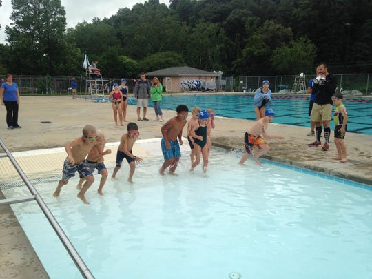Kids get ready to start the Asheville Triathlon Kids' Splash 'N Dash race last year at Recreation Park Pool. The kids-only race will start after the adult race on July 19.