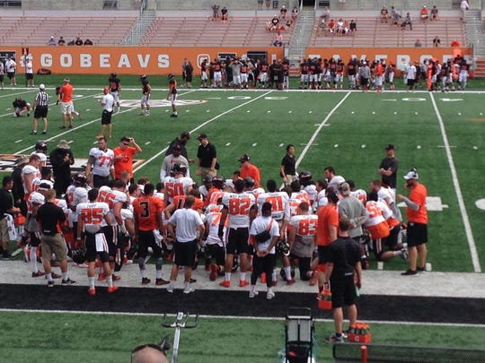 The Oregon State offense between plays at Saturday's scrimmage.