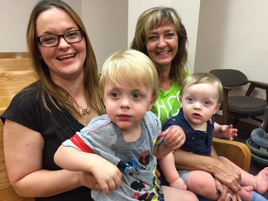 Lisa Pryor sits with her sons, Chance, 2, and Jace,