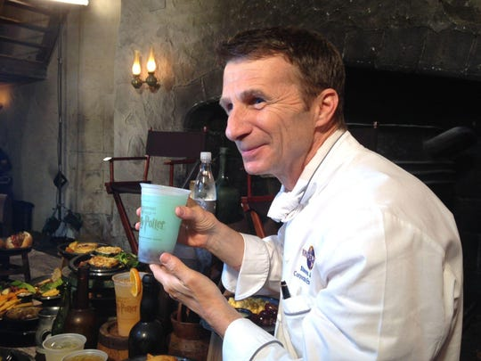 In this June 2014 file photo, Universal Orlando's executive chef Steven Jayson shows off the Fishy Green Ale drink at Wizarding World of Harry Potter — Diagon Alley. Jayson came up with the recipe for Butterbeer.