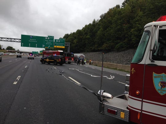 A fuel tanker that reportedly spilled hundreds of gallons of racing fuel on southbound I-95 on Wednesday morning, sits by the highway, where most lanes are closed to traffic.
