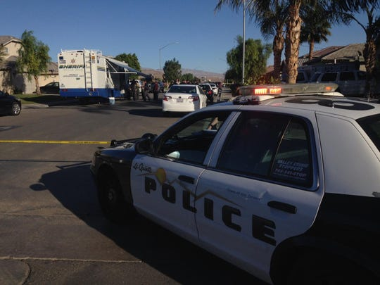 A sheriff's patrol car sits at the scene of a police shooting in this Desert Sun file photo from December 2014.