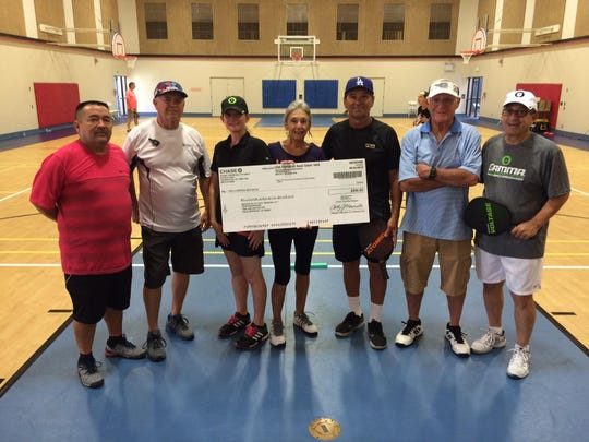 Pickleball players and supporters hold a check for $200 which helped purchase equipment for the Demuth Community Center. From left to right are: Juan Imazu, But Roberts, Jennifer Castle, Marcia Stone, Raudel Barba, Ron Schmeck and Dean Mangione.