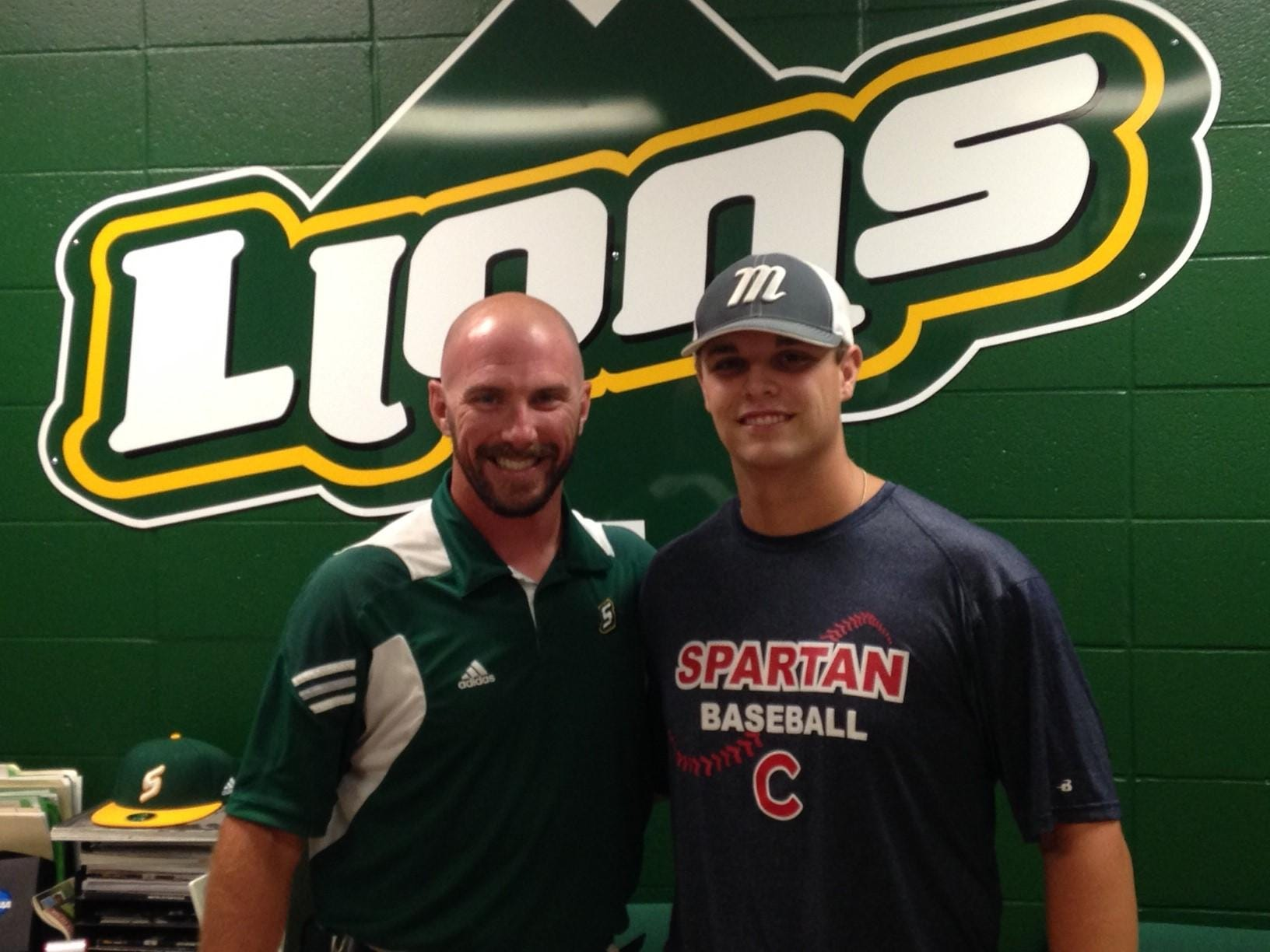 Comeaux High catcher Ben Bayless takes a picture with Southeastern Louisiana Lions' head baseball coach Matt Riser during his official visit to Hammond.