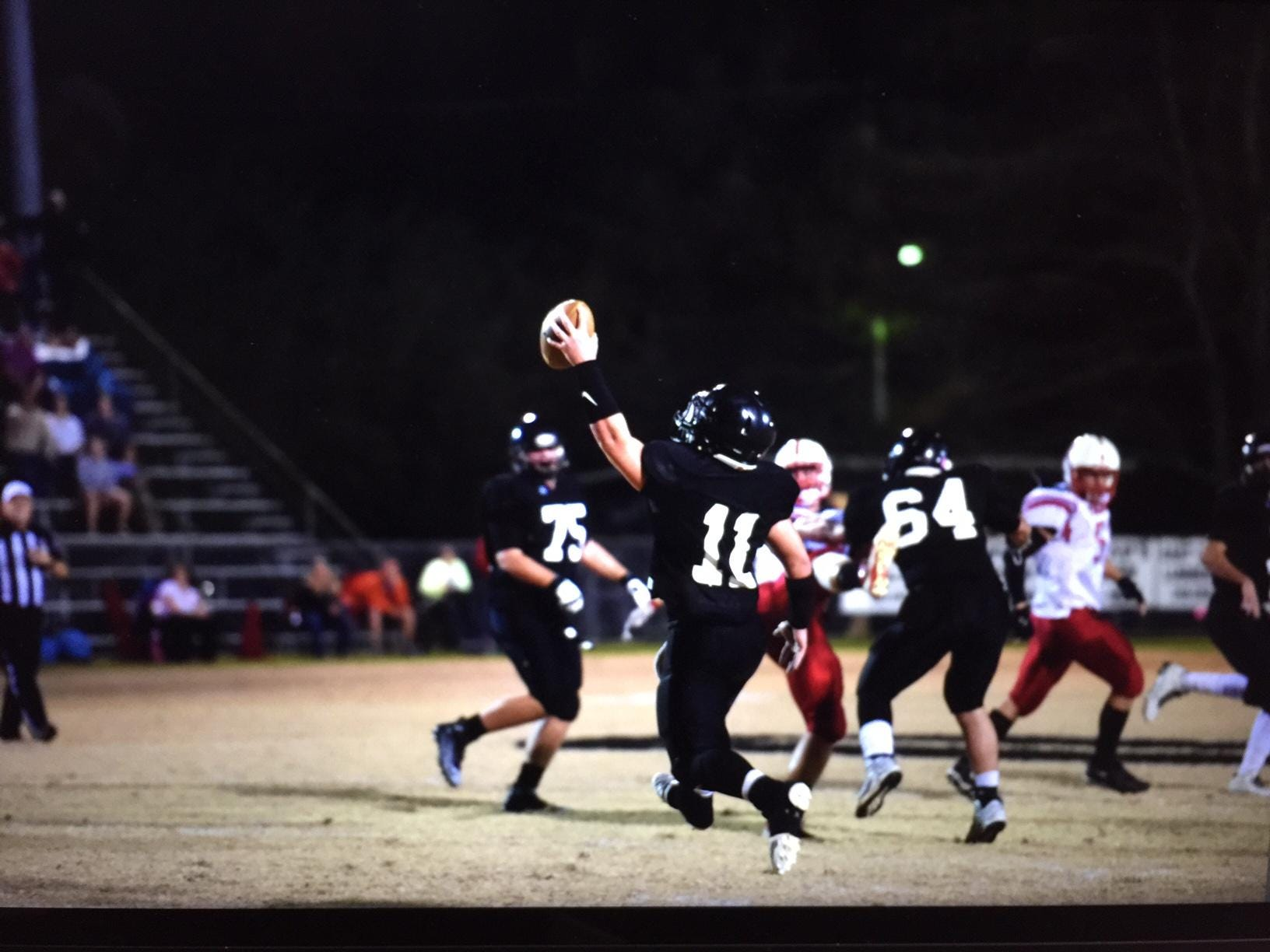 The Oak Grove defense celebrates a stop in its game with East Beauregard.