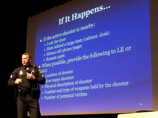 "Monroe County Sheriff's Office Sgt. Brian Wicks speaks during an ""active shooter"" seminar hosted by the Greater Rochester Chamber of Commerce on March 9, 2016."
