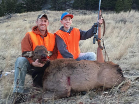 Gavin Grosenick, right, took this elk also on Nov. 15. His dad Brian is on the left.