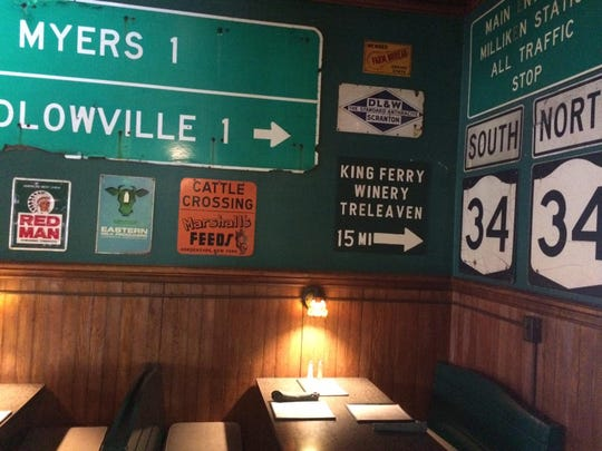 Signs reflecting the region and its history are part of the decor at Rogues' Harbor Inn in Lansing.