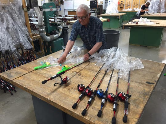 Volunteer Richard Headley says three types of rods and reels will be given to youngsters participating in the annual fishing day Saturday.