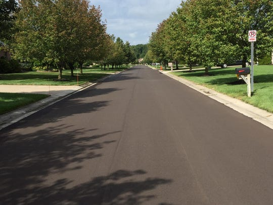 It's smooth riding in places like the River Woods subdivision, where new asphalt paving has occurred.