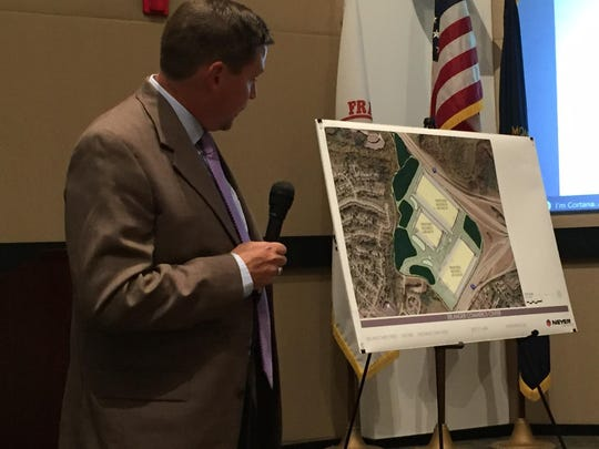 Al Neyer vice president of architecture Patrick Moore presents a map of the former Showcase Cinemas site with the proposed three industrial buildings that they would build.