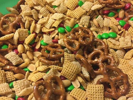 Christmas Mix is a blend of dry ingredients such as Corn and Rice Chex cereals, pretzels, salted peanuts and M&M candies. It's then mixed and coated with white chocolate.