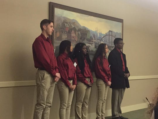 Management students from St. Georges High School, who included Miles Evans, Shayana Gatewood, Adrianna Harris, Jade Lott and Jacob Kenneally, stand in front of judges as they listen to critiques about their restaurant concept idea.