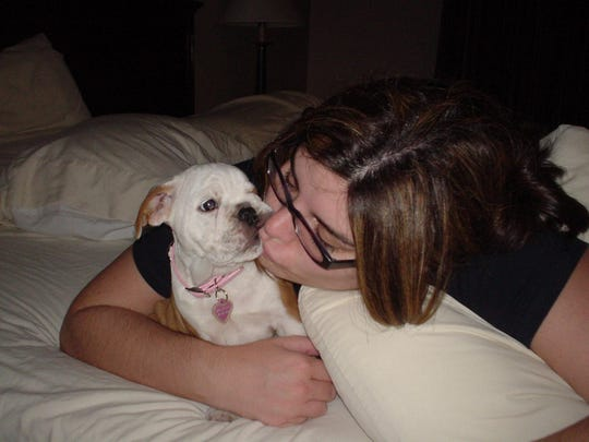 Stacey PAtel gives some love to her dog Millie. Millie passed away at the age of 12 on July 21.