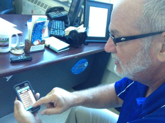 Sayreville War Memorial High School Principal James Brown shows off the high school's new app.