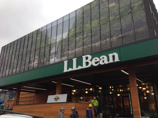 Workers prepare the L.L. Bean store at Town Center Mall in Burlington on Thursday. The store is set to open Nov. 7.